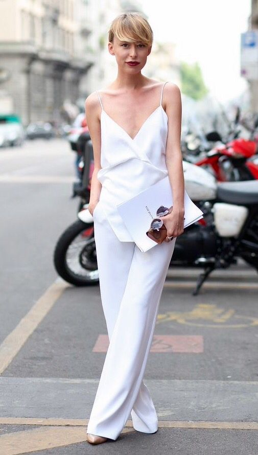 a minimal chic look with a white spaghetti strap jumpsuit, nude shoes and a bold lip