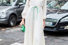 11 a romantic pleated off the shoulder midi dress with green touches and a matching clutch