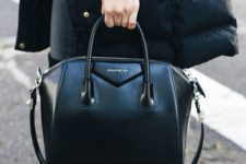 11 a super edgy and chic black Givenchy bag with a structure and a long handle