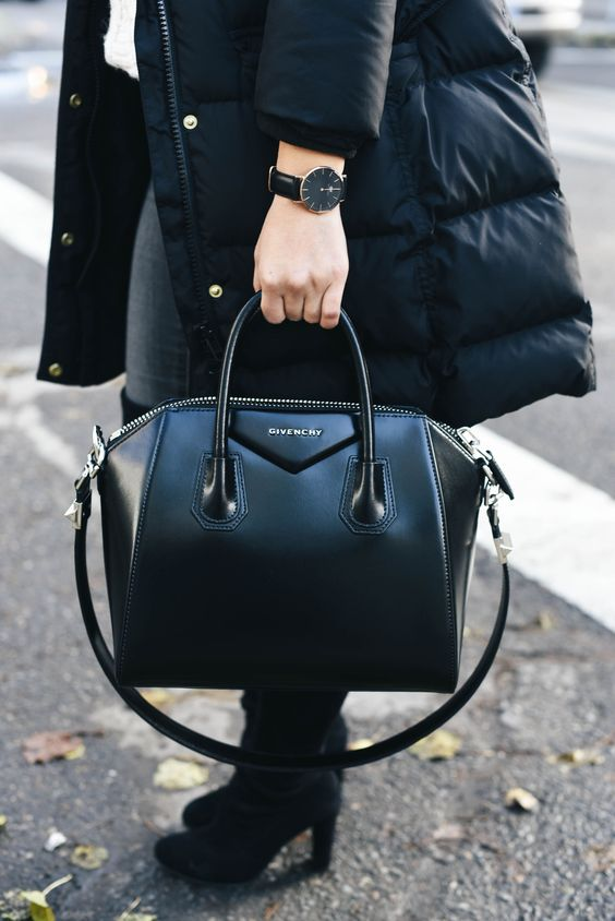 a super edgy and chic black Givenchy bag with a structure and a long handle