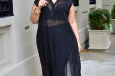 11 black pants, a black top plus a sheer black shirtdress, white shoes