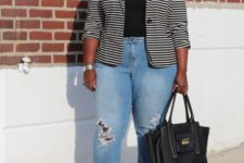 11 blue ripped boyfriend jeans, a printed black tee, a striped jacket and silver shoes
