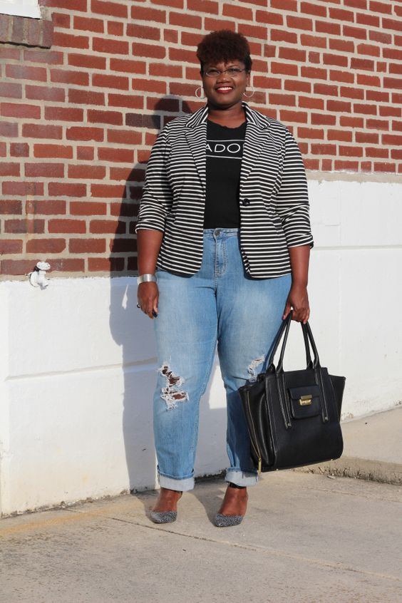 blue ripped boyfriend jeans, a printed black tee, a striped jacket and silver shoes
