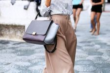 11 blush culottes, a striped shirt, black vintage-inspired shoes and a color block bag
