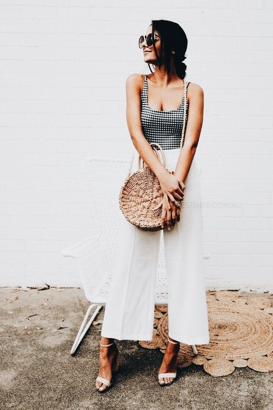 a gorgeous round straw bag combines two hot trends in one