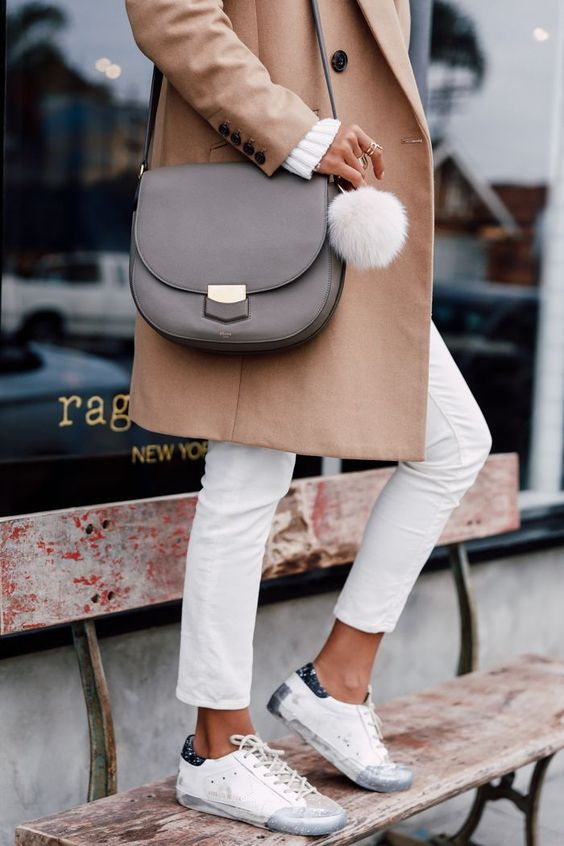 a grey Celine bag with a long strap and a white fluff is a cool and universal idea