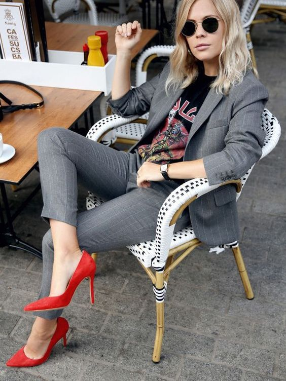 a grey thin stripe pantsuit, a printed tee and red heels for a sexy and edgy look
