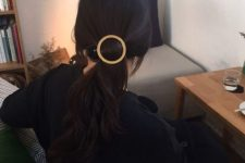 12 a low ponytail with a metallic barrette is a stylish idea