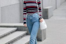 12 a striped top, blue high waisted raw hem jeans, red strappy shoes for a playful touch