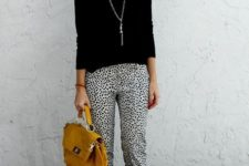 12 dalmatin printed cropped pants, a black top and heels, a statement necklace and a mustard bag
