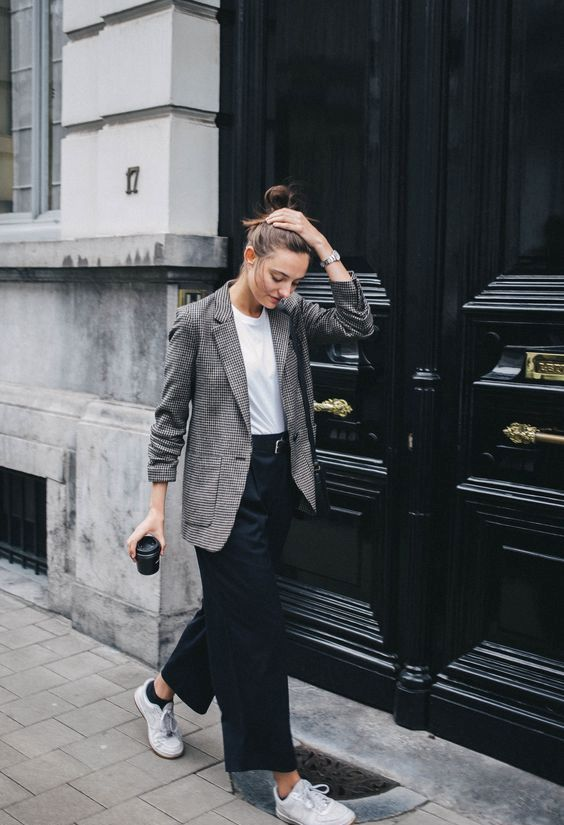 wide black pants, a white tee, a checked blazer and white sneakers for a relaxed casual look