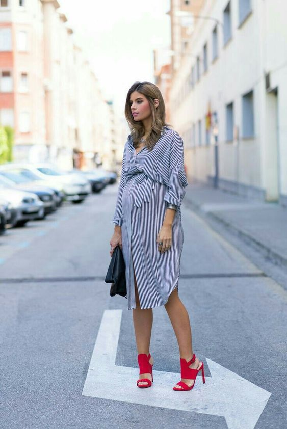 a gorgeous grey shirt dress with side slirts, long sleeves, a sash, red heels
