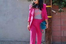 13 a hot pink pantsuit with a printed tee, a blue bag and white sneakers for a colorful look