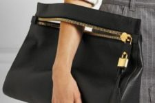 13 a medium-sized black leather clutch with a zip and a bag tag will fit many occasions