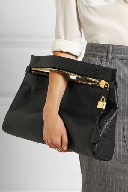 a medium sized black leather clutch with a zip and a bag tag will fit many occasions