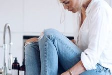13 a white shirt, light blue ripped and raw hem jeans and chic black heels