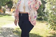 13 black jeans, a white crop top, a floral jacket, green shoes and a statement necklace