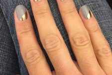 13 matte grey nails with geometric gold accents for a modern look