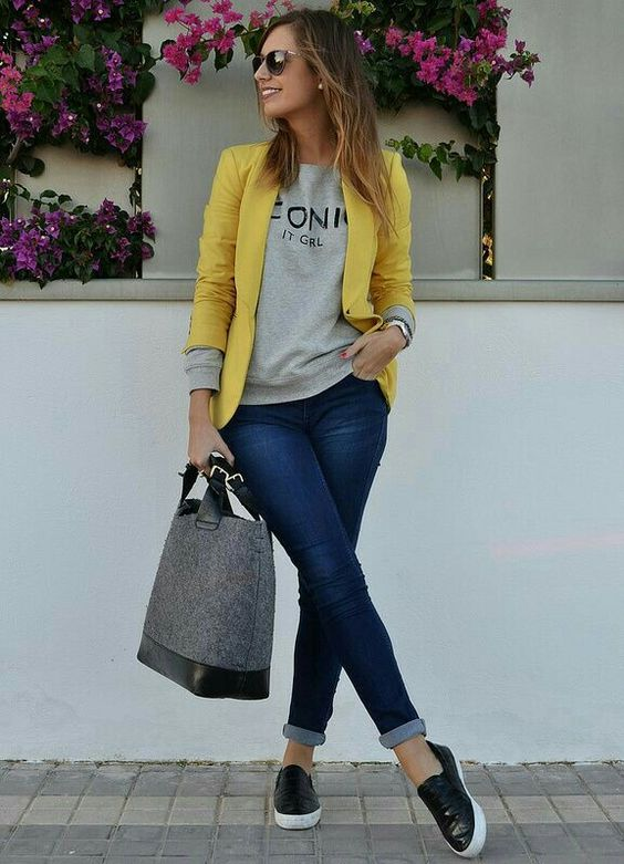 navy skinnies, a grey sweatshirt, black slipons, a yellow jacket