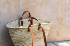 14 a classic straw bag with brown leather detailing is right what you need this summer