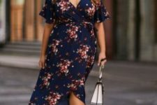 14 a dark floral dress with a V-neckline and black sock boots are a trendy way to rock florals