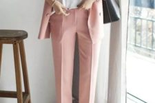 14 a light pink pantsuit with a white tee and white sneakers plus a black bag looks casual