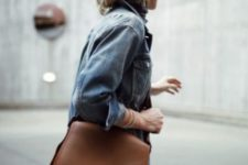 14 a medium-sized brown leather bag with a long and wide strap for a universal look