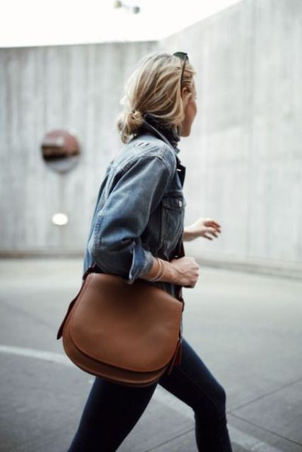 a medium-sized brown leather bag with a long and wide strap for a universal look