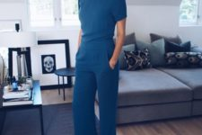 14 a modest teal jumpsuit with short sleeves and pockets is a perfect piece for work