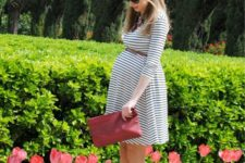14 a simple striped dress, a brown belt, red suede heels and a red clutch
