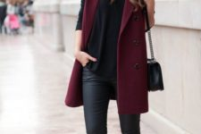 14 black leather leggings, a black tee, burgundy trainers and a burgundy long vest for sport chic fans