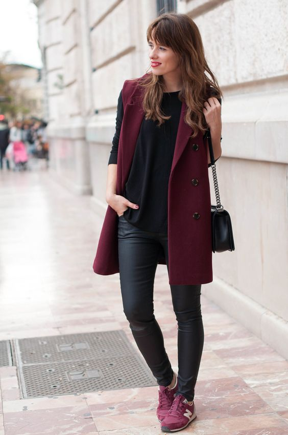 black leather leggings, a black tee, burgundy trainers and a burgundy long vest for sport chic fans