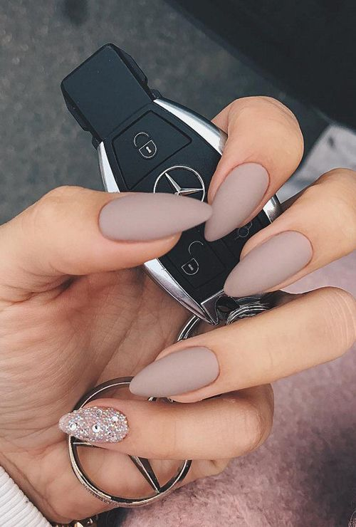 mauve-colored matte almond nails with an accent rhinestone nail