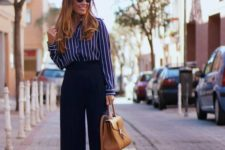 14 navy culottes, a vertical stripe blue and white shirt, tan shoes and a bag