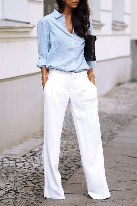 wide creamy pants, a chambray shirt, a black clutch to feel comfy at work