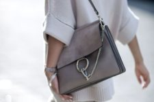 15 a gorgeous grey leather bag with a large metal ring and a chain plus a leather handle for any occaison