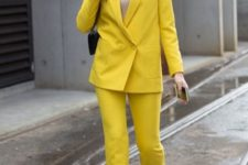 15 a neon yellow pantsuit, a neutral top and black sock boots for a trendy modern look