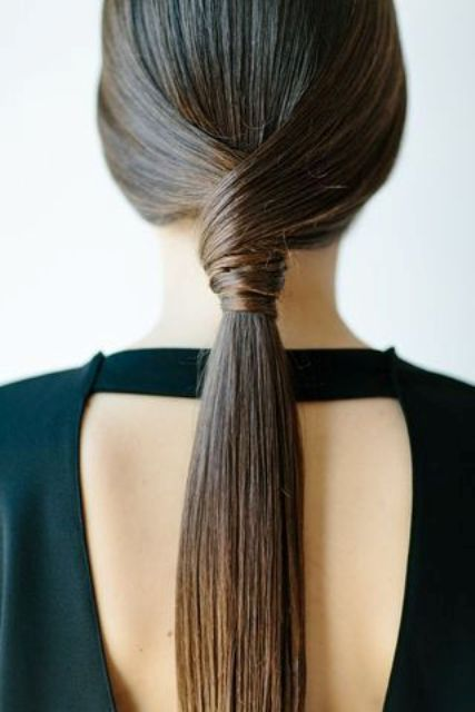 an ultra-minimalist sleek twisted ponytail for a gorgeous look