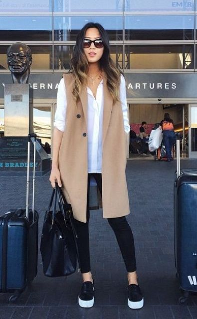 black leggings, a white shirt, a camel vest, black slipons comprise a very comfy look