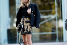 15 metallic shoes, a printed black and gold mini, a black tee and a jacket for a refined look
