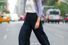 15 navy culottes, navy heels, a white top and a blue printed shirt over it