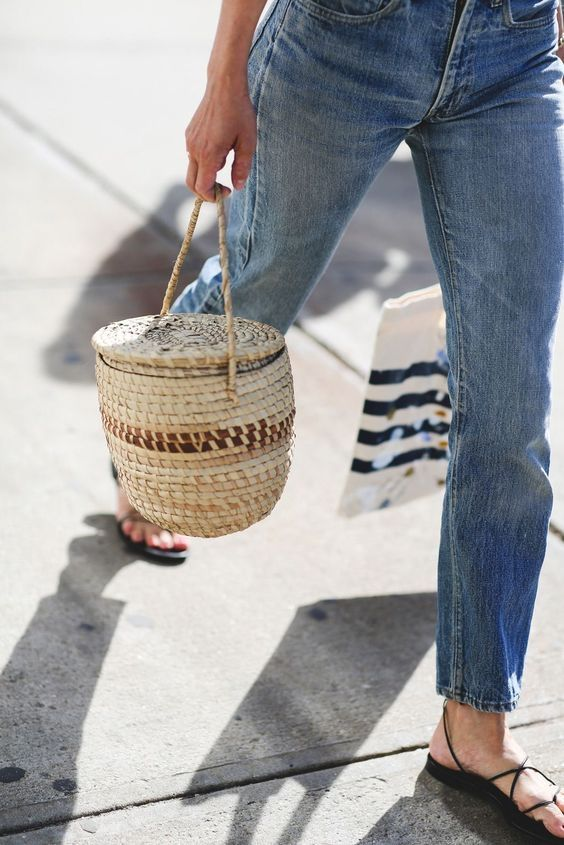 a barrel shaped straw bag to accent a casual outfit and make it even more relaxed