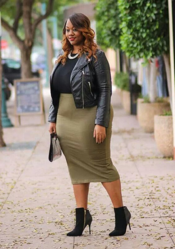 a black top, an olive green pencil skirt, blakc booties, a statement necklace and a leather jacket