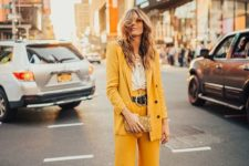 16 a yellow pantsuit, a white top, white mules and layered necklaces for a free-spirited look