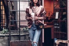 16 blush pumps, blue ripped raw edge jeans, a dusty pink bomber jacket and a small crossbody