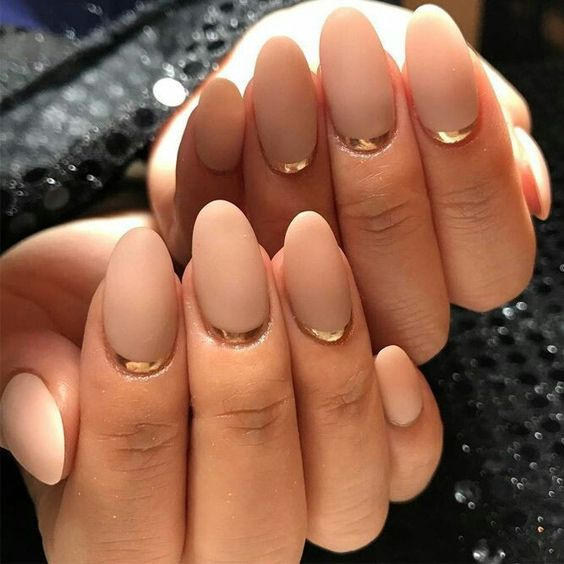 chic almond-shaped nude nails with a metallic accent for a more refined look