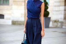16 navy culottes, a navy sleeveless blouse with buttons, green heels for an exquisite look