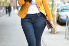 16 navy skinnies, a white top, a yellow jacket, brown shoes and a clutch