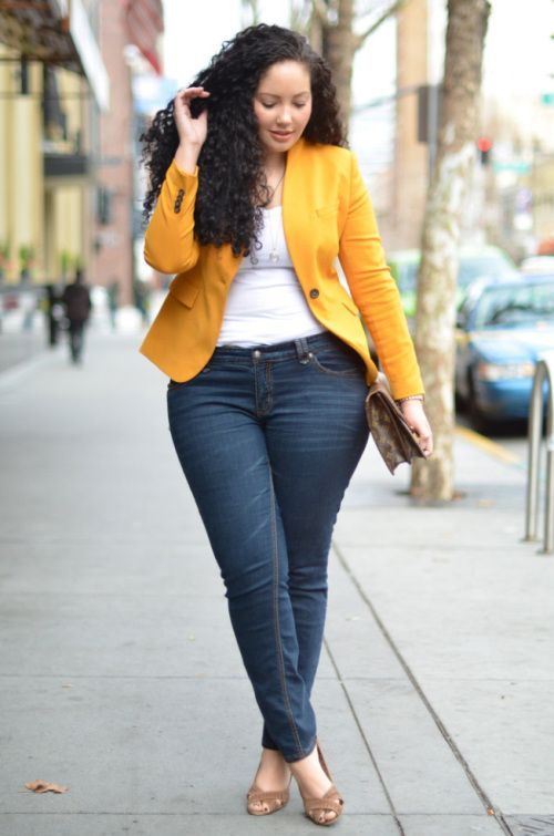 navy skinnies, a white top, a yellow jacket, brown shoes and a clutch