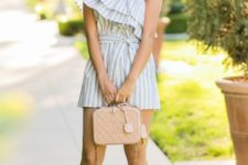 With beige bag and high heels